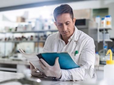 Scientist reading scientific data in a laboratory