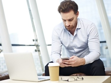 Businessman looking at mobile phone