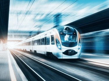 High speed train at the railway station at sunset, photo by den-belitsky/Adobe Stock
