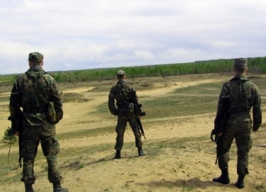 three NATO soldiers on a range