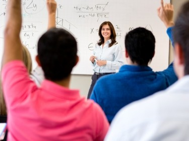 Students in class asking questions to the professor