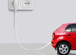 electric car plugged in to wall