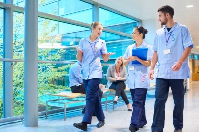 Young nursing staff in an NHS hospital corridor
