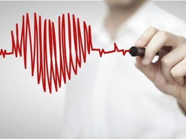 Man drawing a heartbeat-style heart