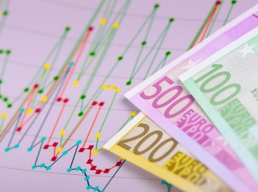 Euros and chart showing financial ups and downs