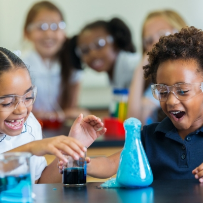 School children perform a chemistry experiment