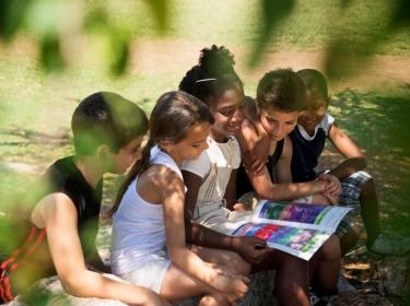 Children reading in a park