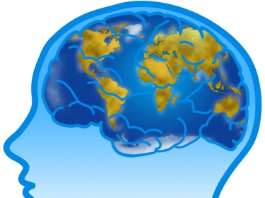 Illustration of profile and visible brain with world planisphere