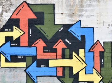 Graffiti arrows on wall