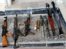 Small arms and rocket-propelled grenades found by Marines from Bravo Company, 1st Battalion, 3rd Marine Regiment in a house in Fallujah