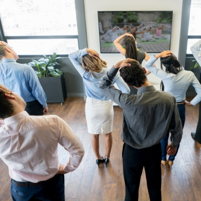Group of business people at the office making an active break and stretching ther bodies