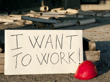 Sign indicating desire to work