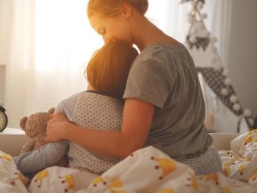 Mother waking child in morning, photo by Evgeny Atamanenko/Adobe Stock