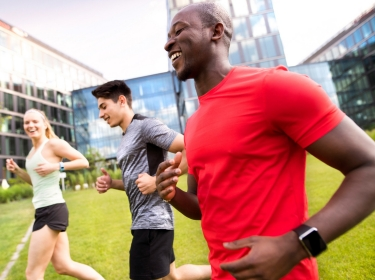 Young people in the city running together, photo by Halfpoint/Adobe Stock