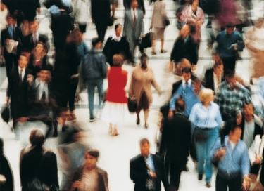blurred photo of pedestrians