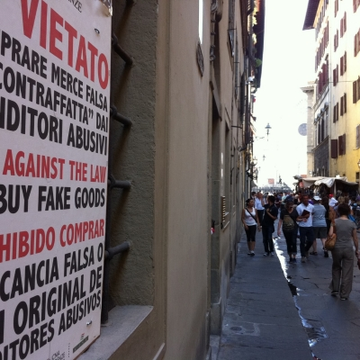 Italian sign forbidding purchase of counterfeit merchandise