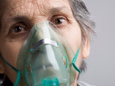 woman in oxygen mask