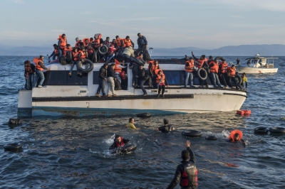 Syrian and Iraqi refugees arrive from Turkey to Skala Sykamias, Lesbos island, Greece, where Spanish volunteers help them in October 2015