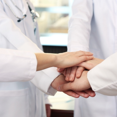 A medical team works together to provide unified care