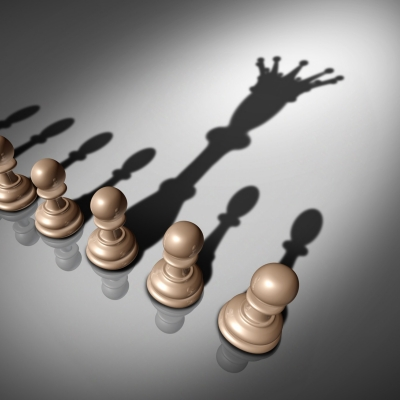 Chess pawns and king shadow, as metaphor for leadership search