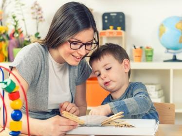 Preschool teacher and student in classroom