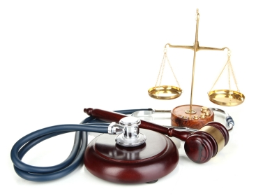 Gavel, scales and stethoscope