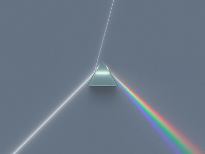 A dispersive equillateral prism refracting and reflecting an incoming beam of uniform white light rendered into the sRGB IEC61966-2.1 color space