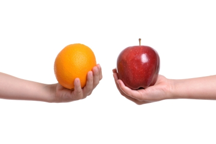 apple,orange,hands,holding,compare,fruit,food,isolated,white background,different,concept,objects,organic,produce,comparison,juicy,diet,healthy,red,fingers,extended,colorful