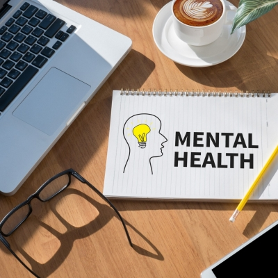 Desktop with 'Mental Health' on notepad