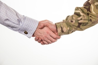 Civilian and serviceman shaking hands