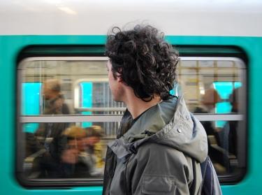 Man watching subway train go past