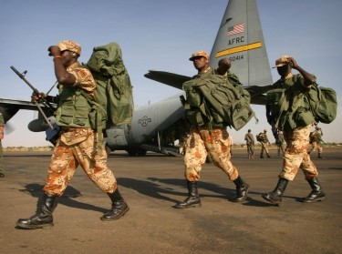 Rwandan troops arrive on a U.S. Air Force C-130 cargo plane at El Fasher airport in Darfur, as part of an African Union peacekeeping effort in western Sudan, October 30, 2004, photo by Finbarr O'Reilly/Reuters