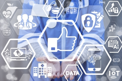 Doctor holds out hands in front of tech screen with 'like' icon, photo by wladimir1804/Adobe Stock