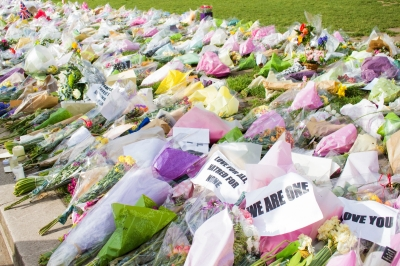 Flowers lying on the grass after a terrorist atack in London