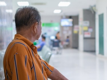 Elderly patient waiting for a doctor in hospital, photo by pongmoji/Adobe Stock