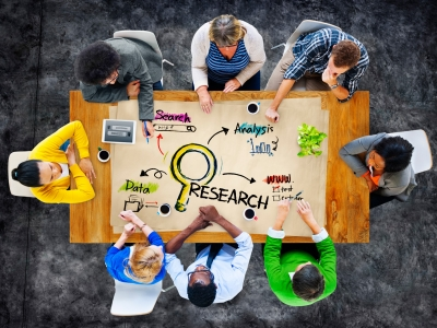 Multiethnic group of people in a research meeting