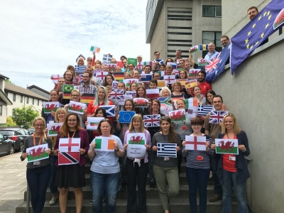 Scientists of South Wales Immunology display flags of their home countries