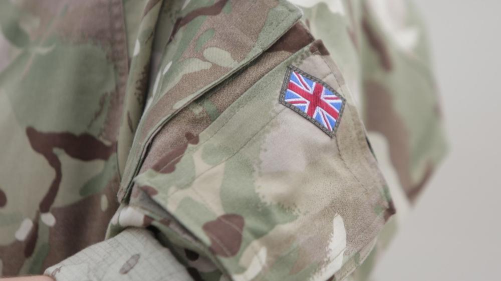 Union Jack on British soldier's uniform, photo by MoiraM/Adobe Stock