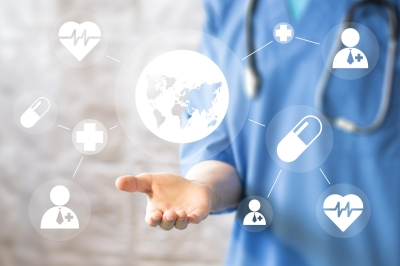Doctor working with modern computer interface map, photo by maxsim/Adobe Stock