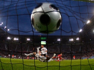 Germany's Lukas Podolski scores past Poland's goalkeeper Artur Boruc at the Woerthersee Stadium in Klagenfurt, Austria, June 8, 2008