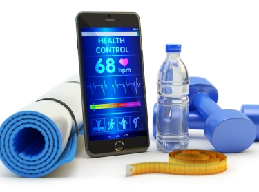 Yoga mat, mobile phone, dumbbells, bottle of water and measuring tape