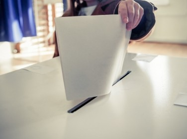 A voting paper being placed into a ballot box