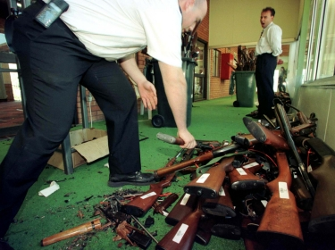 Guns that have just had their barrels crushed in Sydney are stacked after they were handed over on the last day of the Australian gun buyback scheme, September 1997.