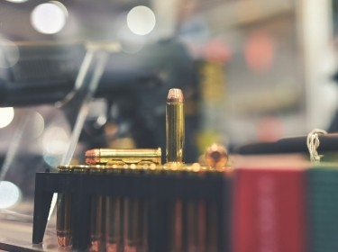 Bullets and firearm on a retail store counter