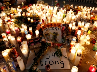 A candlelight vigil is pictured on the Las Vegas strip following a mass shooting at the Route 91 Harvest Country Music Festival in Las Vegas, Nevada, October 2, 2017