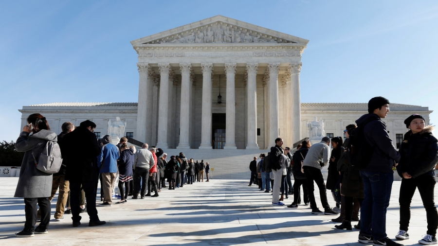 Visitors stand in line outside the U.S. Supreme Court
