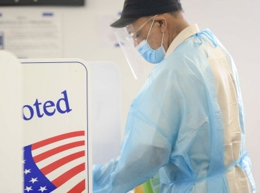 A poll worker disinfects booths after every use during early voting in Knoxville, Tennessee, July 17, 2020, photo by Cavin Mattheis/News Sentinel