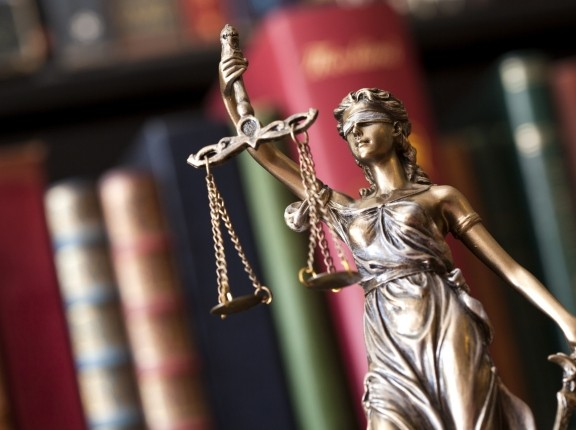 A statue of Themis holding the scales of justice