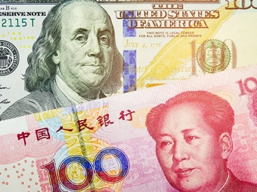 Close up of the U.S. dollar and Chinese yuan bills
