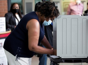 Priscilla Bennett is the first person in Philadelphia to cast an early ballot for the 2020 election, on Temple University's campus in Philadelphia, Pennsylvania, September 29, 2020, photo by Rachel Wisniewski/Reuters